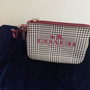 Plaid coach wristlet with maroon details